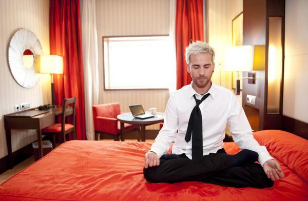 Man meditating before work